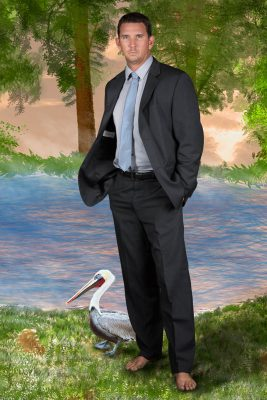 Jerry Reid and a pelican with drawn backdrop